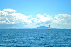 Sailboat with blue sky Stock Images