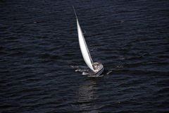 Sailboat and blue water Royalty Free Stock Photos