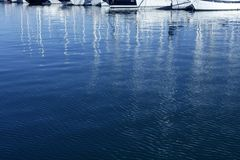 Sailboat blurred mast reflexion on the marina Stock Image