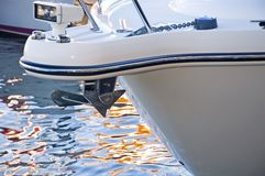 Sailboat bow and anchor. A view of the bow and bow anchor housing of a luxury yacht as it is tied to a dock Royalty Free Stock Images