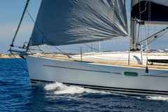 Sailboat bow with hoisted genoa is sailing in the Mediterranean Stock Photography