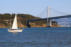 Sailboat and bridge Royalty Free Stock Photo