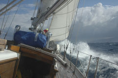 Sailboat in brisk winds Stock Image