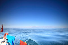 Sailboat british yacht sailing in blue sea Stock Photography