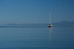 Sailboat on Calm Sea. S Cadboro Bay in Victoria, BC Royalty Free Stock Photos