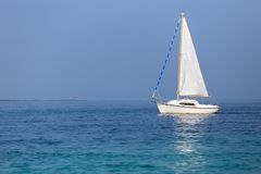 Sailboat on calm sea Royalty Free Stock Photo