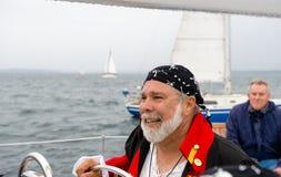 Sailboat captain stock photo