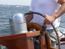 Sailboat Captain. Captain at the helm of a sailboat Royalty Free Stock Photos