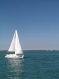 Sailboat in Chicago harbor. Lone single mast sailboat in Chicago harbor Royalty Free Stock Images