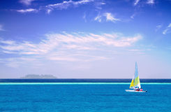 Sailboat in clear sky along Maldive coast Royalty Free Stock Images