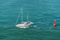 Sailboat on Clear Waters Stock Images