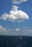 Sailboat and cloud Stock Images