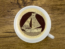 Sailboat in the coffee cup Royalty Free Stock Photos
