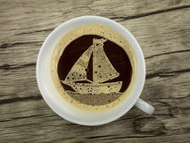 Sailboat in the coffee cup Stock Image