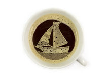 Sailboat in the coffee cup Royalty Free Stock Photo