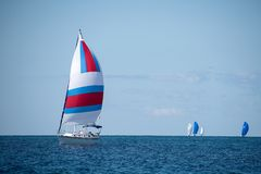 Sailboat with colorful spinnaker Royalty Free Stock Photography