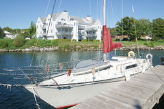 Sailboat & Condo Royalty Free Stock Photos