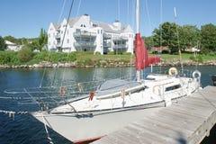 Sailboat & Condo. A Sailboat in front of a condo building royalty free stock photos