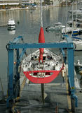 Sailboat on crane Royalty Free Stock Photos