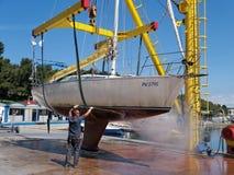 Sailboat on crane Royalty Free Stock Image