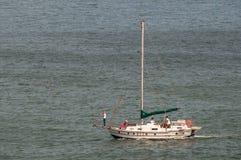 Sailboat cruising on engine power at Gordons Bay Royalty Free Stock Photo