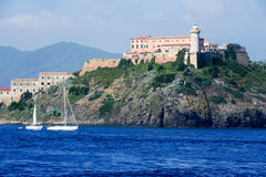 Sailboat cruising in front of Portoferraio on Elba island Royalty Free Stock Photography