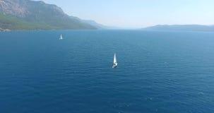 Sailboat cruising at Gokova Gulf Turkey Aerial. 4096x2160 stock video
