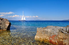 Sailboat cruising in the sea, summertime, travel photo Royalty Free Stock Image