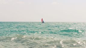 Lonely sailboat is on the Pacific Ocean royalty free stock images