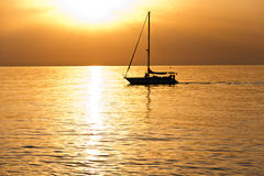 Sailboat at dawn Stock Photo