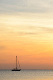 Sailboat at dawn Stock Images
