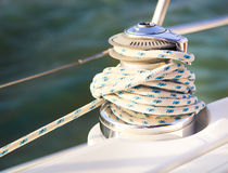 Sailboat detailed parts. Close up on winch and rope of yacht ove Stock Photography