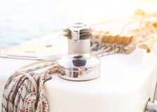 Sailboat detailed parts. Close up on winch and rope of yacht ove Royalty Free Stock Image