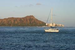 Sailboat and Diamond Head in Waikiki Hawaii. A small sailboat with Diamond Head Crater in the background. Waikiki, Honolulu, Hawaii Stock Photography
