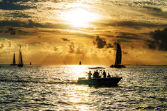 Sailboat and disherman at sunset Royalty Free Stock Images