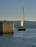 Sailboat and dock Stock Images
