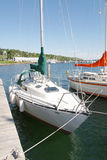 Sailboat at the dock. A White sailboat tied up at a dock Royalty Free Stock Images