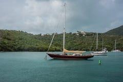Sailboat Docked in Maho Bay Stock Images