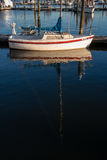 Sailboat docked on still water Stock Images