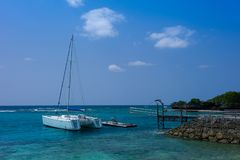 Sailboat docking at Okinawa. `s beautiful dock, floating on the clear blue water stock photo