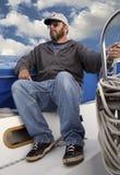 Sailboat driver. Sailor steering his sailboat royalty free stock photo