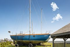 Sailboat in dry dock. Beside the Saint Lawrence seaway in Riviere du Loup, Quebec, Canada Royalty Free Stock Photo