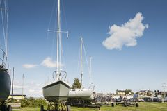 Sailboat in dry dock. Beside the Saint Lawrence seaway in Riviere du Loup, Quebec, Canada Stock Images
