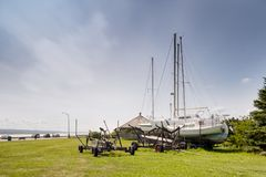 Sailboat in dry dock. Beside the Saint Lawrence seaway in Riviere du Loup, Quebec, Canada Royalty Free Stock Photos