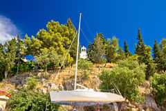 Sailboat on dry dock and stone chapel Royalty Free Stock Photos