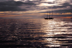 Sailboat at dusk Royalty Free Stock Photos