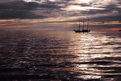 Sailboat at dusk Royalty Free Stock Photos