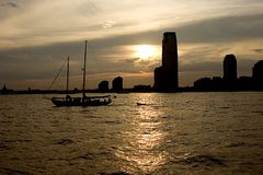 Sailboat at Dusk. Silhouette of a sailboat in the Hudson Royalty Free Stock Photo