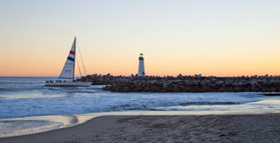 Free Sailboat Enters The Harbor Channel Stock Images - 28409204