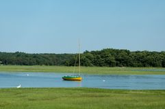 Sailboat in Essex River. Sailboat in the Essex River, Essex, MA, on a clear summer day stock photography